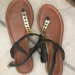 ALDO black and gold thong sandals